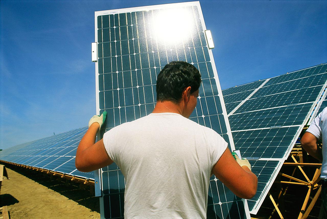 Man with solar panels, Leipzig, Germany